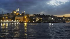 night view of rustem pasha mosque and the waterfront of istanbul, turkey