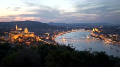 view of the of buda castle, chain bridge and danube river at sunset from citadella in budapest, hungary