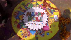 """a colorful """"happy holi """" sign painted on the ground for holi celebrations in jaipur, india"""