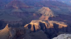a sunset panning left view of  sun shining on part of the grand canyon national park from hopi point in arizona, usa