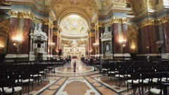 tilt up clip of the interior looking towards the altar of st stephen's basilica in budapest, hungary