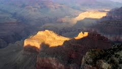 zoom in on sunlit canyon walls at hopi point of the grand canyon in arizona, usa