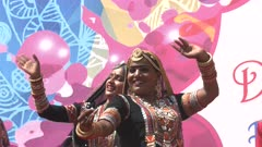 two beautiful female indian dancers in traditional dress perform during holi celebrations in jaipur, india