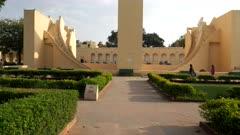 a gimbal clip walking towards the world's largest sundial at jantar matar in jaipur, india
