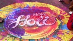 close up of a colorful painted happy holi sign on the ground for holi celebrations in jaipur, india
