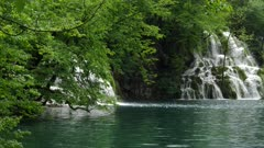 panning right clip of milanovacki slap waterfall and lake at plitvice lakes national park in croatia