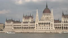 daytime close up of the hungarian parliament and river danube in budapest, hungary