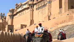 several mahout riding elephants at amer fort in jaipur, india