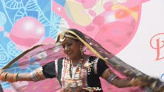a female dancer spins around during a performance at a holi party in jaipur, india