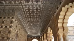 wide view of mirror tiles on a palace ceiling at amber fort in jaipur, india