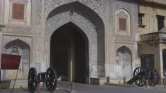 city palace entrance gate and antique cannon in jaipur, india