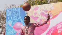 a male indian dancer balances a jar on his head at a holi party in jaipur, india