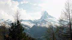 springtime afternoon shot of the matterhorn and a forest at zermatt, switzerland