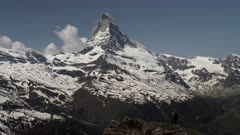 zoom in on a hiker admiring the matterhorn mountain in zermatt, switzerland