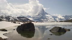 spring morning shot of the matterhorn mountain with lake stellisee in the foreground near zermatt, switzerland
