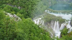 a high angle pan of a waterfall at plitvice lakes national park in croatia