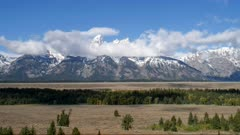 time lapse of storm clouds clearing from teton mountain range at grand teton national park in wyoming, usa