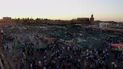 dusk view of the famous jemaa el-fnaa bazaar in marrakesh, morroco
