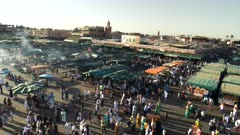 panning right clip of the jemaa el-fnaa bazaar on a spring afternoon in marrakech, morroco