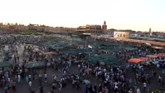 panning right clip at sunset of the famous main bazaar in marrakesh, morroco
