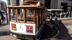 workers rotate a cable car on a historic turntable at san francisco in northern california, usa