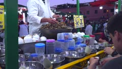 cooked escargot for sale at an outdoor restaurant in the jemaa el-fnaa market of marrakech, morroco