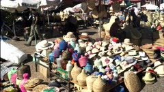 outdoor market stalls selling baskets, hats and other woven goods at marrakesh, morroco