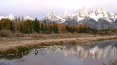 sunrise pan of the teton mountains on an autumn morning at grand teton national park in wyoming, usa