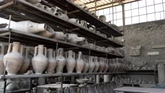 zoom in on ancient roman amphora on display at pompeii ruins near naples, italy