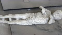 pan of a plaster cast of a child victim of the volcanic eruption at pompeii ruins near naples, italy