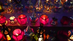 high angle night shot of lanterns with lit candles at the main market in marrakech, morroco