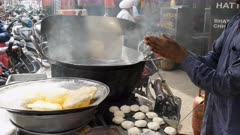 high frame clip of a cook making poori bread in amritsar, india