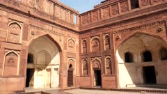 panning shot of the exterior of two buildings at red fort in agra, india