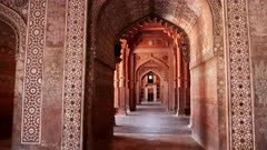 a gimbal stabilized shot walking east in the buland darwaza gate at fatephur sikri near agra, india