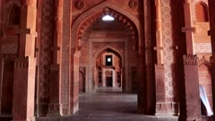 a gimbal stabilized clip walking west in buland darwaza gate at fatehpur sikri near agra, india