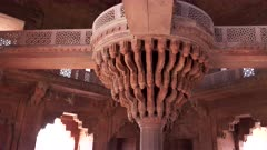 gimbal clip walking towards the famous carved column in the diwan-i-khas at fatephur sikri near agra, india