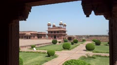 gardens and the diwan-i-khas building framed by an arch at fatephur sikri near agra, india- editorial use only