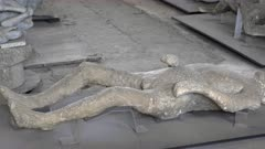 pan of a plaster cast of a victim of the eruption of mt vesuvius at pompeii ruins near naples, italy