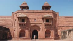 high frame rate shot of tourists exiting a palace at fatephur sikri complex near agra, india