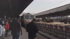 high frame rate close shot of a train arriving at agra train station in india