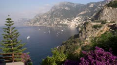 long shot of the town of positano on a summer morning at the amalfi coast of southern italy