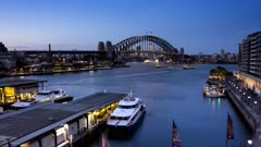a day to night time lapse of ferry traffic at circular quay in sydney, australia