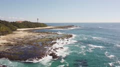 stationary aerial view of norah head lighthouse on the central coast of nsw, australia