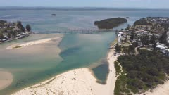 aerial approaching clip of the entrance bridge during a summer midday on the nsw central coast of australia