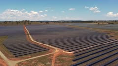 descending aerial clip of a solar farm at parkes in western nsw, australia