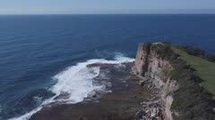 aerial view flying seaward past the skillion at terrigal on the nsw central coast of australia