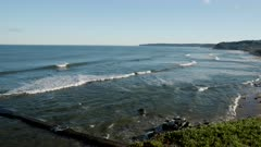 panning clip, looking to the south, of merewether beach at newcastle in nsw, australia