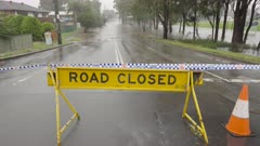road closed sign at rifle range rd during windsor floods in nsw, australia