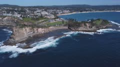 aerial approaching shot of the skillion and the haven at terrigal on the nsw central coast of australia
