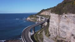 close up aerial clip of sea cliff bridge- flying forward to the south at stanwell park on the nsw south coast of australia